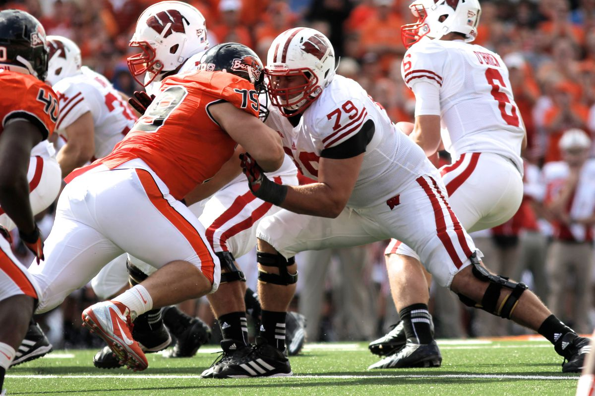 Wisconsin's offensive line struggled mightily Saturday, as the Badgers gained just 35 yards on the ground. Line coach Mike Markuson was fired Sunday after just two days on the job.