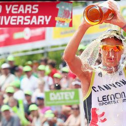 Nils Frommhold of Germany celebrates finishing second during the Challenge Roth on July 20, 2014 in Roth, Germany. (Photo by Alex Grimm/Getty Images)
