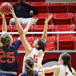 Making her the all time leader at the University of Utah with 226 blocks, forward Emily Potter (12) blocks the shot of Saint Mary's forward Megan McKay (25) as Utah hosts Saint Mary's at the Huntsman Center in Salt Lake on Saturday, Dec. 2, 2017.