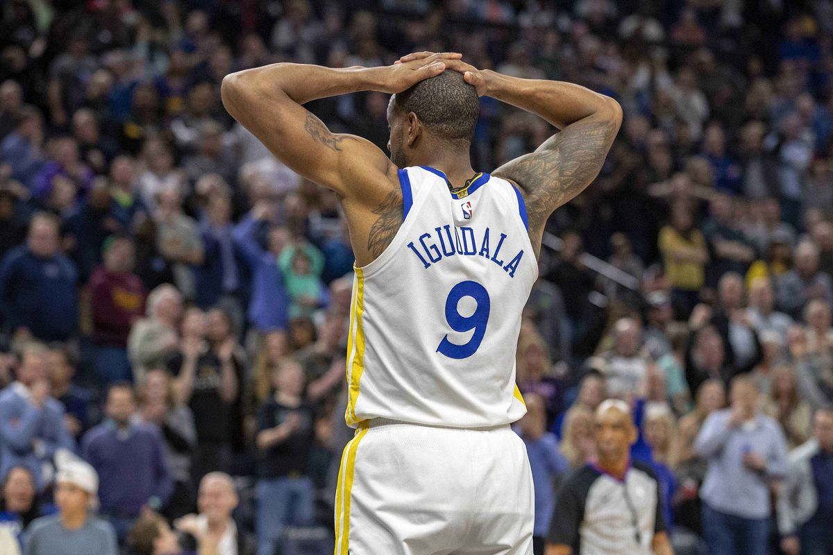 Golden State Warriors guard Andre Iguodala looks on after getting a foul called on him during overtime against the Minnesota Timberwolves at Target Center.