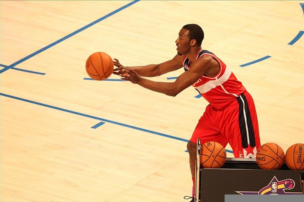 February 25, 2012; Orlando FL, USA; John Wall of the Washington Wizards passes during at the 2012 NBA All-Star Skills Challenge at the Amway Center. Mandatory Credit: Kim Klement-US PRESSWIRE