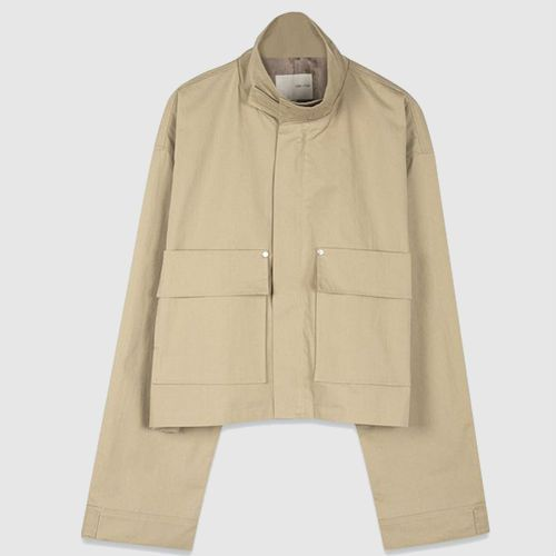 Cropped beige jacket with mock neck and over-sized sleeves.