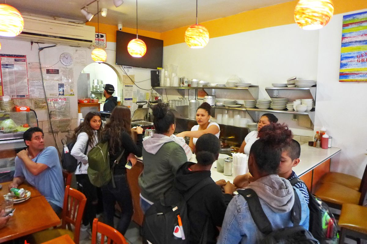 Gena's fills up with students at lunchtime.