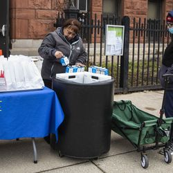 Edith Quinones, the lunchroom manager, packs a bag of three days of free breakfast and lunch meals for students at William P. Nixon Elementary School, 2121 N. Keeler Ave., Thursday morning, March 19, 2020.