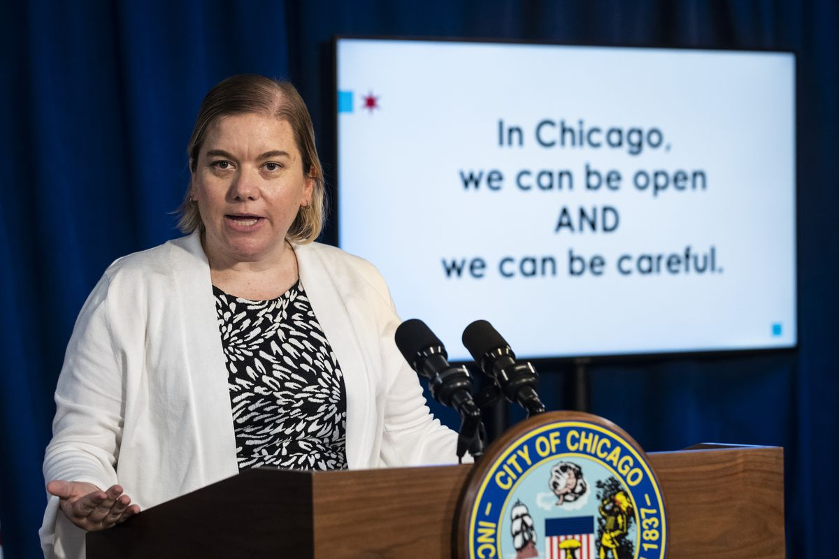 Dr. Allison Arwady, commissioner of the Chicago Department of Public Health, discusses Chicago's COVID-19 response during a news conference in August at City Hall in the Loop.