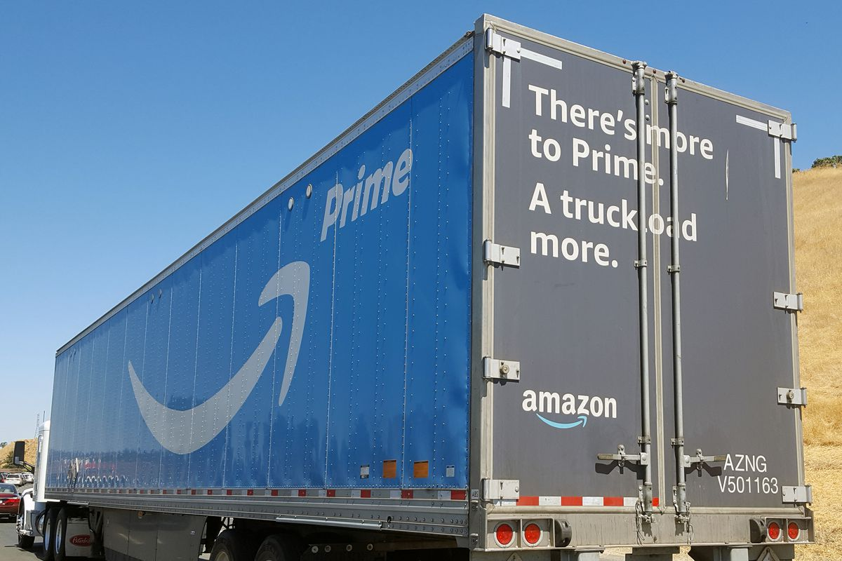 """An Amazon Prime tractor trailer truck with the text, """"There's more to Prime. A truckload more."""""""