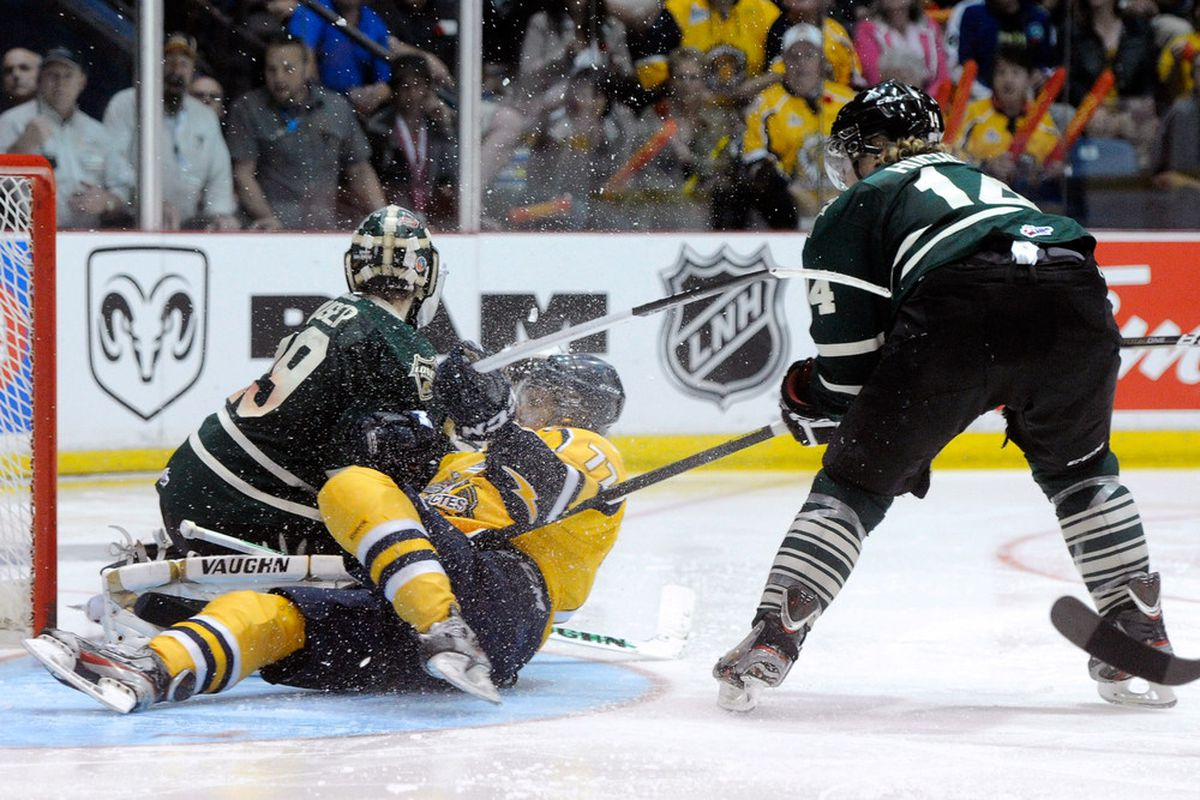 Kirill Kabanov #77 of the Shawinigan Cataractes collides with goaltender <strong>Michael Houser </strong>#29 of the London Knights during a 2012 MasterCard Memorial Cup game at Bionest Centre, May 27 in Shawinigan, Quebec.