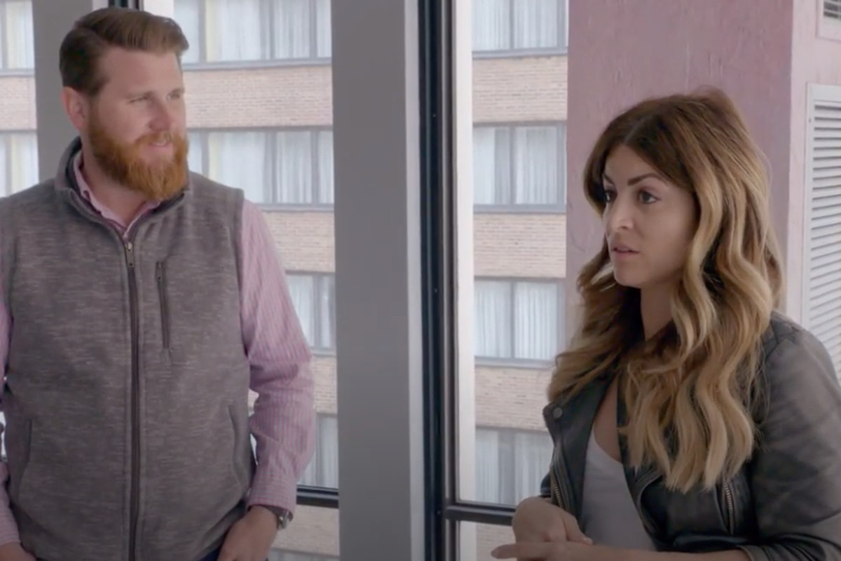 "Alison Victoria and Donovan Eckhardt go over plans during a scene from Tuesday night's episode of ""Windy City Rehab."""