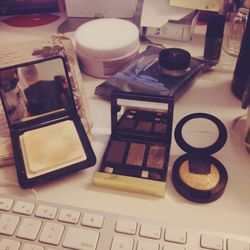 I'm going out to dinner after work, and have zero shame about doing my makeup at my desk. I'm going to use the gold from this baked <b>MAC</b> shadow on the inner corner of my eyes, and the glittery taupe from the <b>Tom Ford</b> trio on my lids. It's the