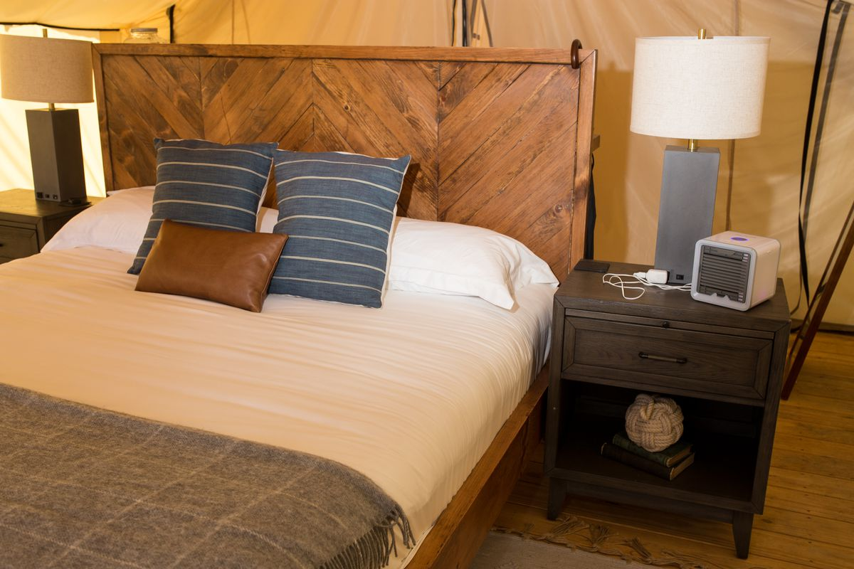 Queen size bed in glamping tent