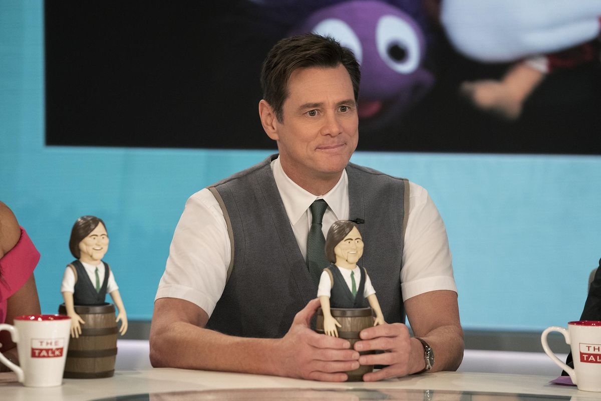 jim carrey in the second season of kidding holding an action figure with long hair that looks like his character from season 1