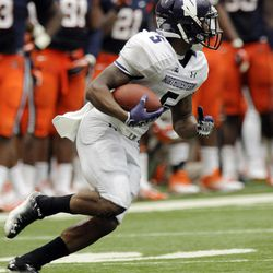 Northwestern's Venric Mark (5) returns a kick for a touchdown against Syracuse's during the first quarter of an NCAA college football game in Syracuse, N.Y., Saturday, Sept. 1, 2012.