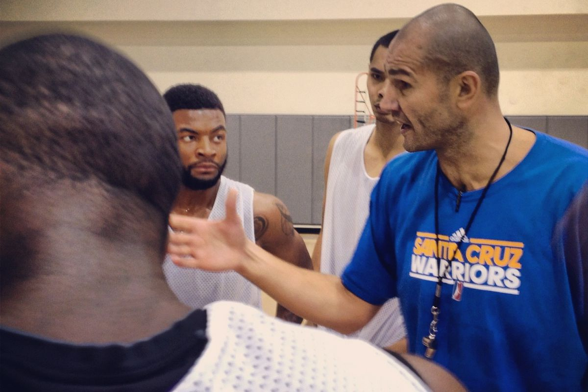 Santa Cruz Warriors assistant coach, and former NBA player, Vitaly Potapenko talking X's and O's with players