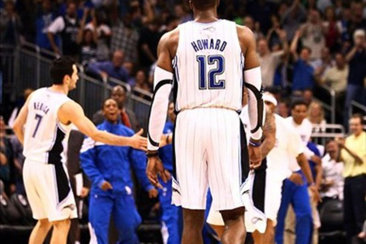Mar 13, 2012; Orlando, FL, USA; Orlando Magic center Dwight Howard (12) walks off the court for a time out during the fourth quarter at Amway Center. Orlando defeated Miami 104-98 in overtime. Mandatory Credit: Douglas Jones-US PRESSWIRE