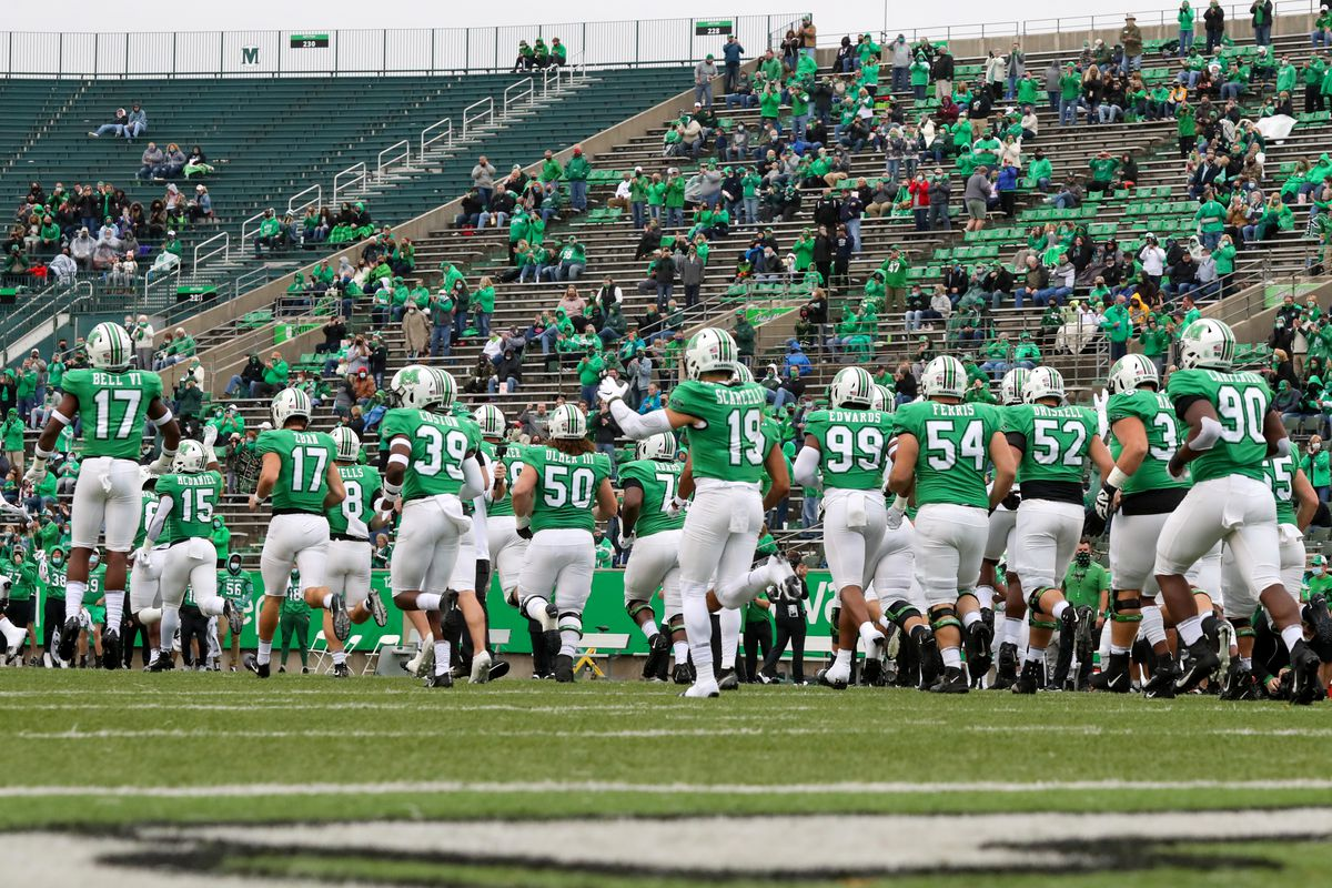 The Marshall Thundering Herd take the field prior to the college football game between the Florida Atlantic Owls and the Marshall Thundering Herd on October 24, 2020, at Joan C. Edwards Stadium in Huntington, WV.