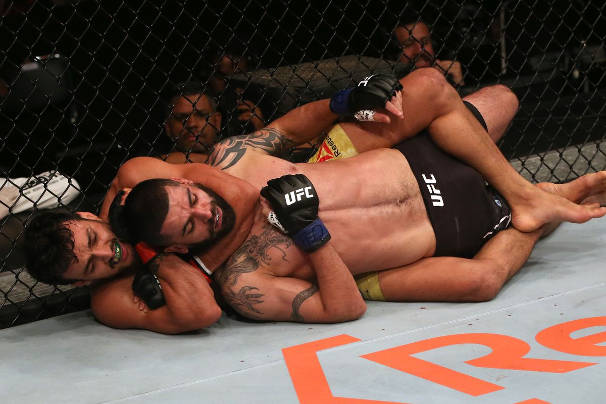 Ricardo Ramos of Brazil secures a rear choke submission against Eduardo Garagorri of Uruguay in their featherweight fight during the UFC Fight Night event at Ibirapuera Gymnasium on November 16, 2019 in Sao Paulo, Brazil.