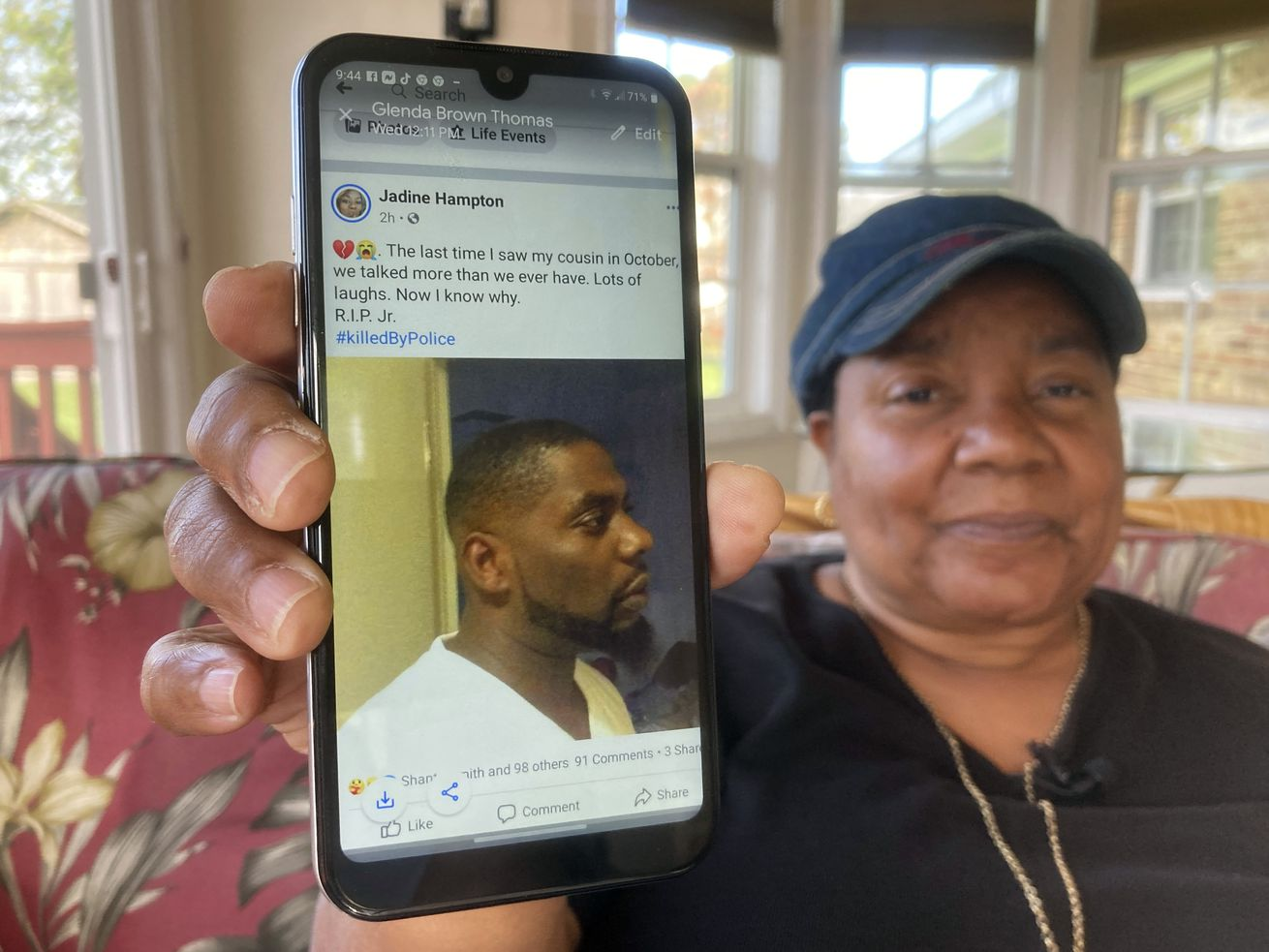 Glenda Brown Thomas displays a photo of her nephew, Andrew Brown Jr., on her cellphone at her home in Elizabeth City, N.C., on Thursday, April 22, 2021. Brown was shot and killed Wednesday by a sheriff's deputy, who was attempting to execute a warrant.