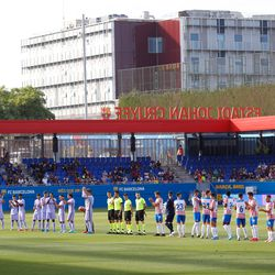 The teams line up ahead of kick-off
