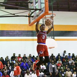 Curie's DaJuan Gordon (3)  goes up for a dunk in the second half,Tuesday 01-08-19. Worsom Robinson/For the Sun-Times.