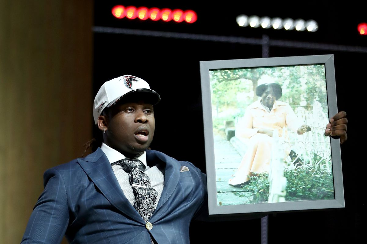 PHILADELPHIA, PA - Former UCLA Bruins defensive end/outside linebacker Takkarist McKinley poses with a photograph of his grandmother after being picked 26th overall by the Atlanta Falcons at the Philadelphia Museum of Art.