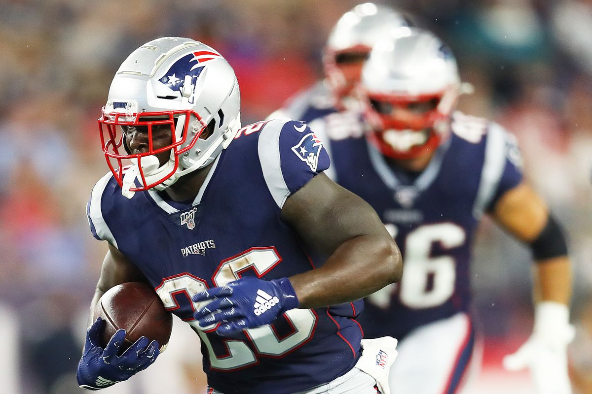 Sony Michel of the New England Patriots runs the ball during the preseason game between the Carolina Panthers and the New England Patriots at Gillette Stadium on August 22, 2019 in Foxborough, Massachusetts.