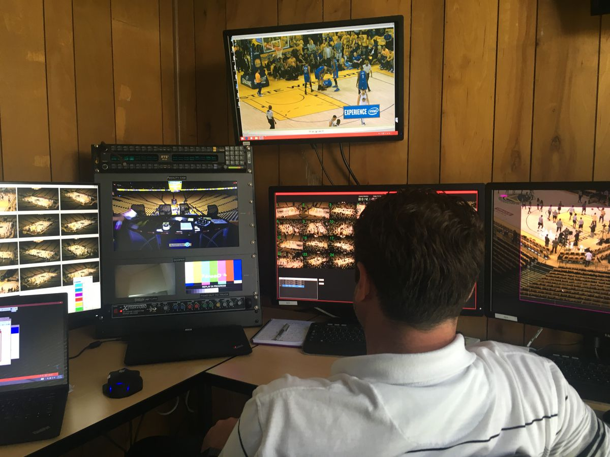 An Intel employee watches the Golden State Warriors game, deciding which plays are suitable for a 360-degree replay.