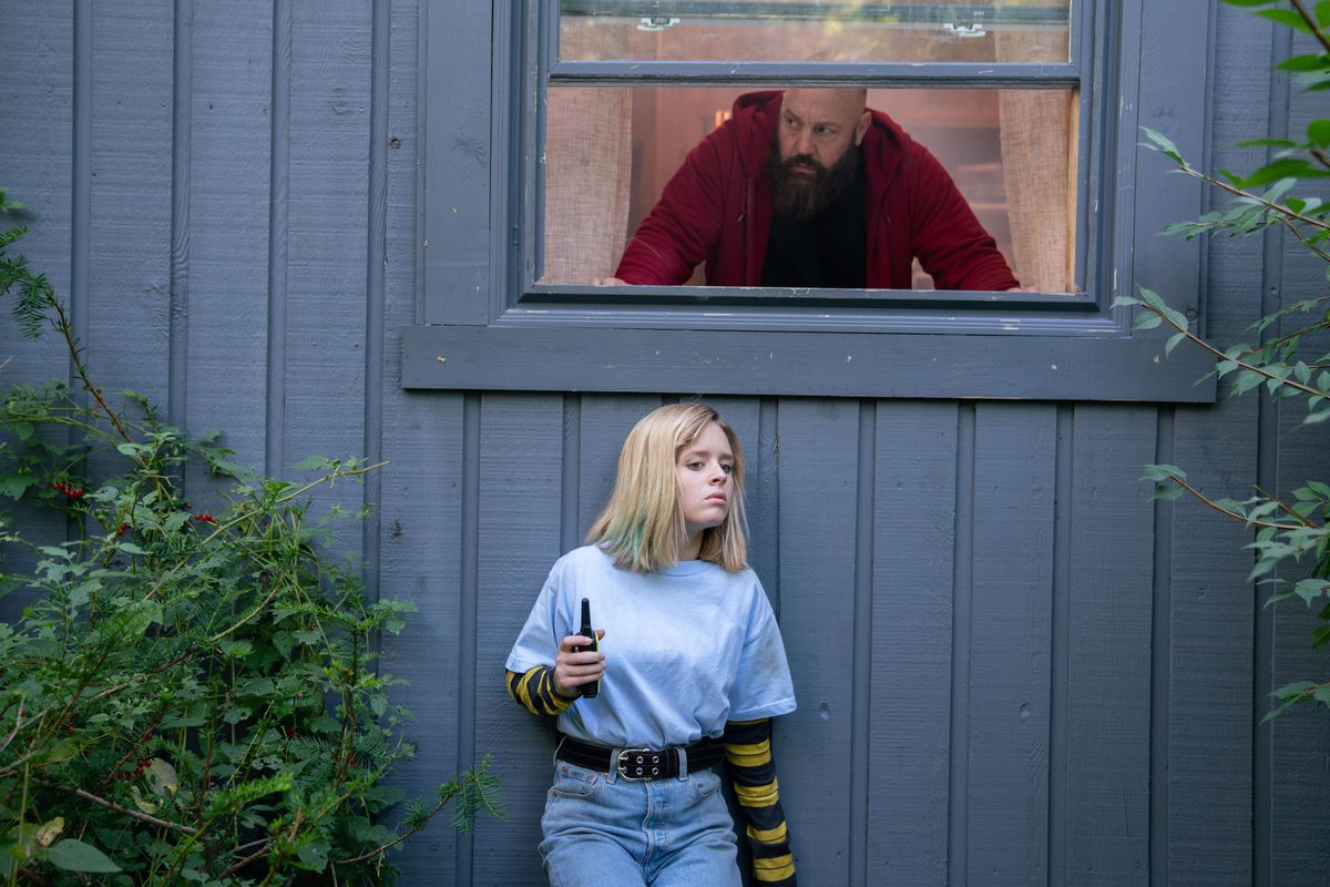 kevin james looks out from a window as lulu wilson hides beneath