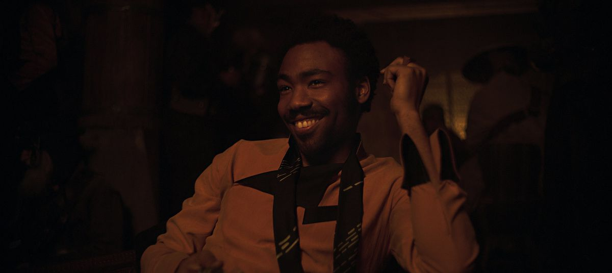 Lando Calrissian smiling in Solo: A Star Wars Story
