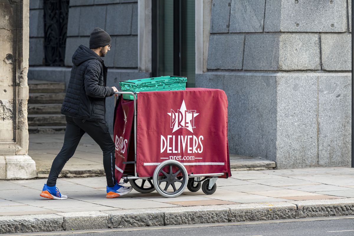 A Pret a Manger deliveryman moves on the street during coronavirus lockdown