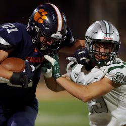 Brighton's Lander Barton tries to fend off Olympus' James Smith as they play a high school football game at Brighton in Cottonwood Heights on Friday, Sept. 10, 2021. Olympus won 35-28.