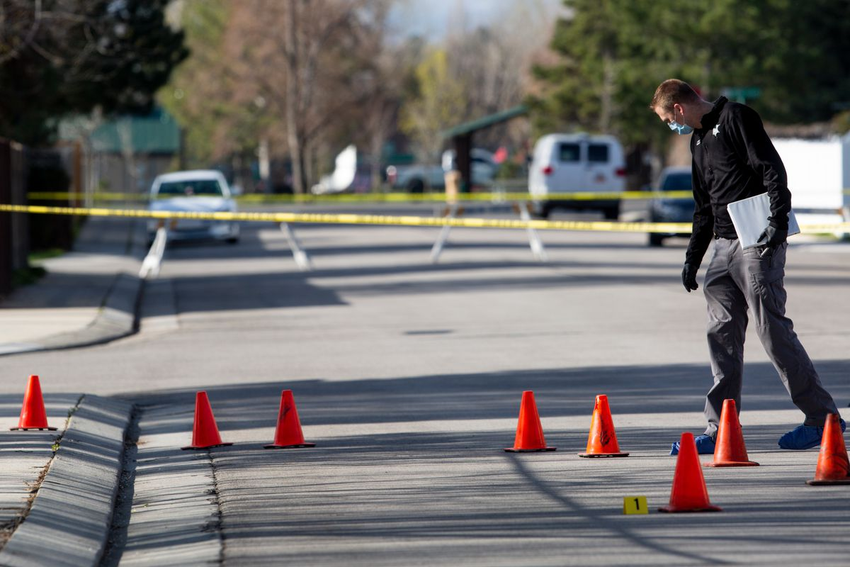 A police officer investigates a double homicide in West Jordan on Saturday, April 18, 2020.