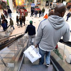 Today, the powerful and iconic mall is fading as mobile shopping rules the day. Still, our collective mall memory is strong and the mall might not be dead, but rather just embarking on its next evolution. (AP Photo/Detroit News, Bryan Mitchell)