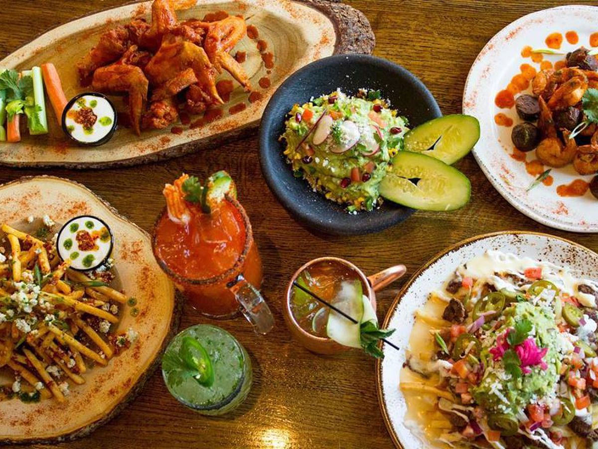 Tacos, enchiladas, Mexican food, and margaritas at a table setting at Patria Cocina in Atlanta.