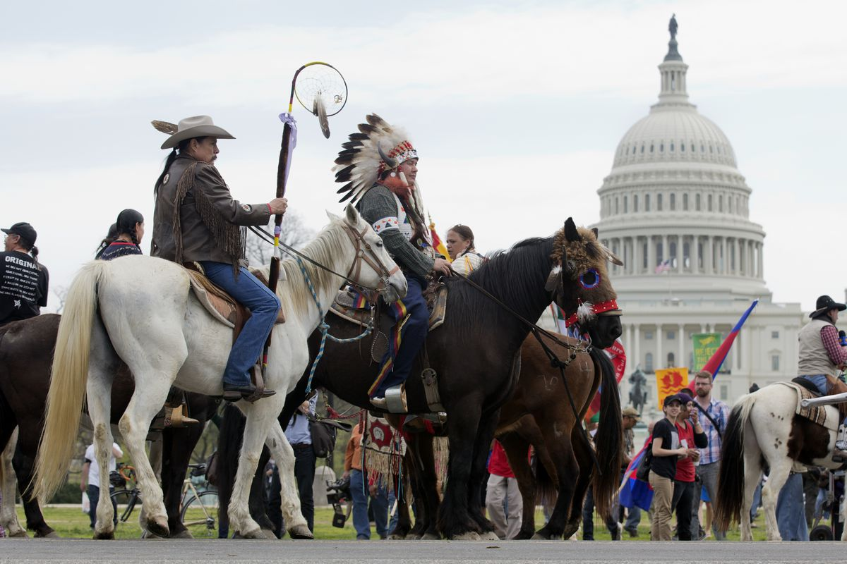 Shane Red Hawk of the Sioux Tribe rides a horse alongside others protesting the Keystone XL pipeline in April 2014.