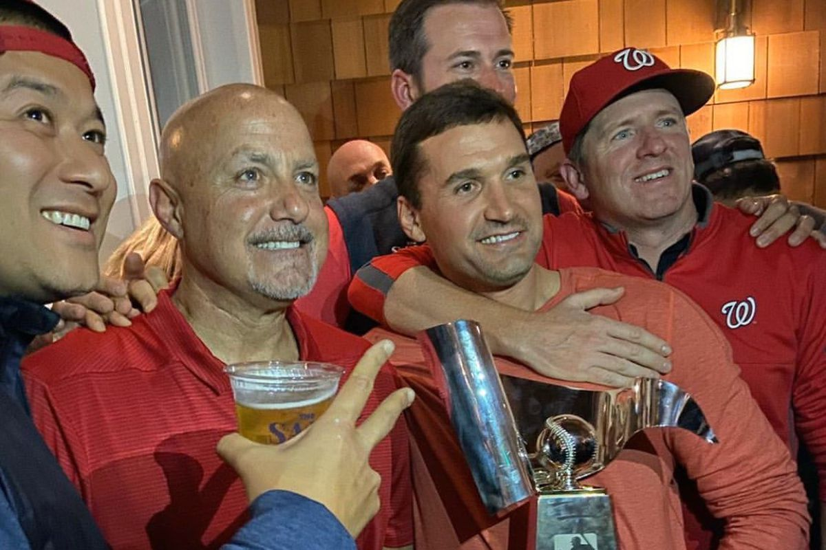GM Mike Rizzo and Ryan Zimmerman celebrate their NLCS win at the Salt Line.