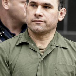 """FILE - In a Friday, Feb. 9, 2007 file photo, accused Mexican drug kingpin Osiel Cardenas-Guillen, 39, leaves the federal courthouse in Houston after pleading not guilty to charges connected to running a cartel that at its height smuggled four to six tons of cocaine per month into the country. Cardenas-Guillen's nephew Rafael Cardenas Vela, a Gulf cartel member of distinguished lineage who ran three important """"plazas"""" or territories, recently testified to the organization's structure and operations in such detail that it could compose a short course _ Narco 101, perhaps."""