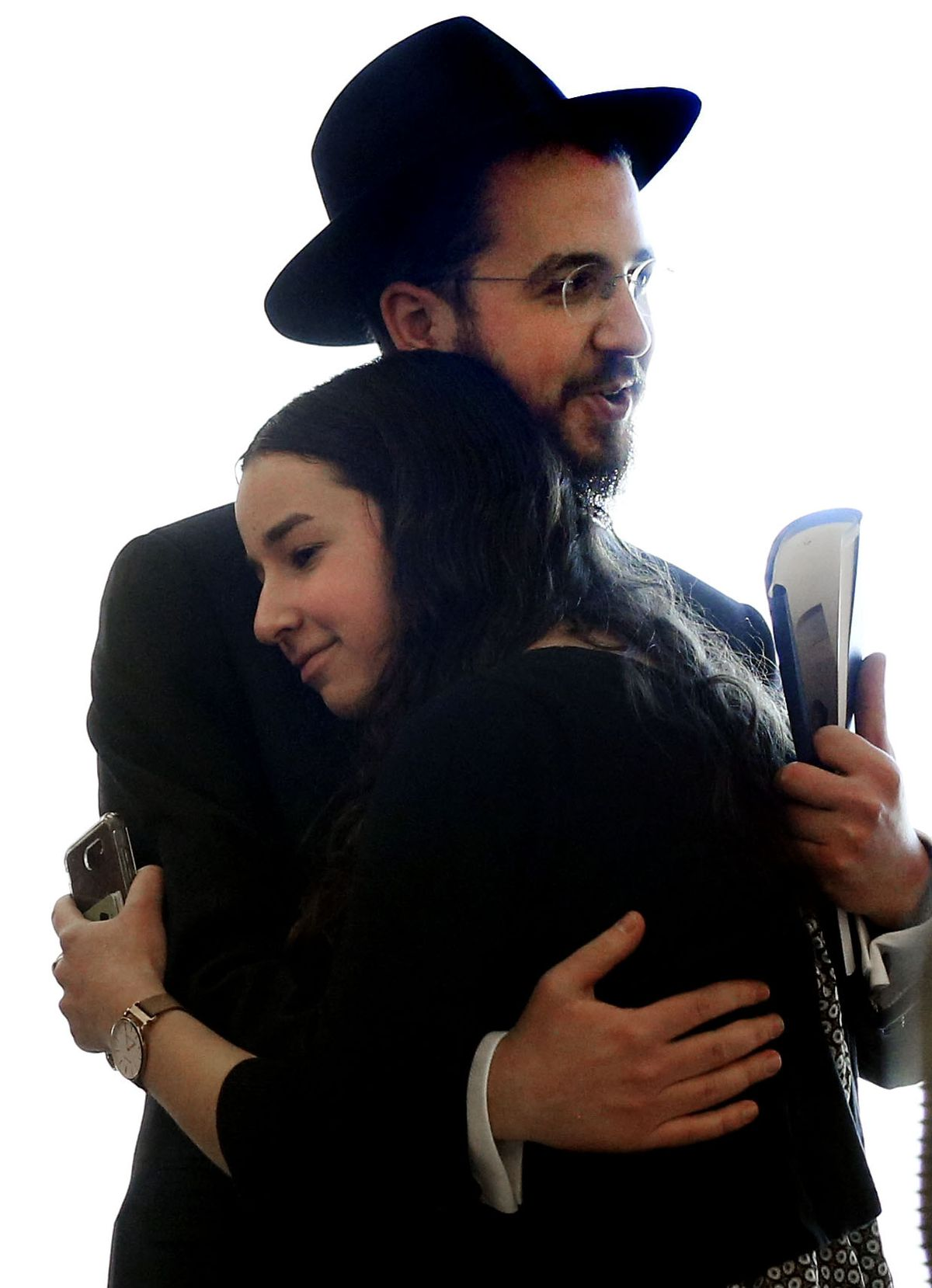 """Rabbi Avrohom """"Avremi"""" Zippel hugs his sister, Sarah Zippel, after the sentencing of Alavina Fungaihea Florreich at the Matheson Courthouse in Salt Lake City on Thursday, March 12, 2020. Florreich, the longtime nanny convicted of sexually abusing Zippel, has been ordered to serve 25 years to life in prison."""