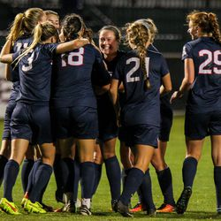 UConn women's soccer team celebrates Toriana Patterson's goal.