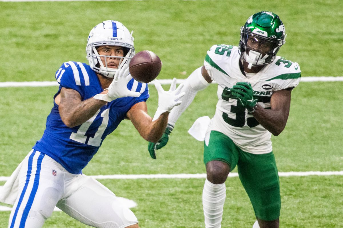 Indianapolis Colts wide receiver Michael Pittman catches the ball while New York Jets cornerback Pierre Desir defends in the second half at Lucas Oil Stadium.