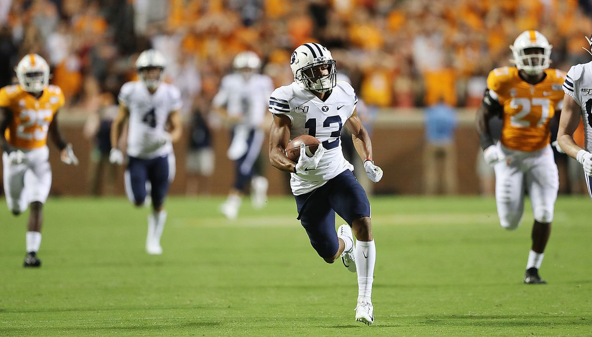 Brigham Young Cougars wide receiver Micah Simon (13) runs in the open field after making a catch, setting up the game-tying field goal, as BYU and Tennessee play a game in Knoxville on Saturday, Sept. 7, 2019. BYU won 29-26 in double overtime.