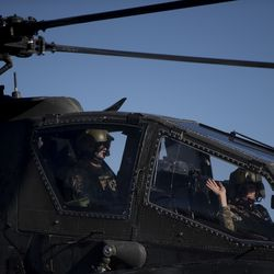 A Utah Army National guardsman waves goodbye as the 1st Attack/Reconnaissance Battalion, 211th Aviation Regiment departs the Utah Army National Guard armory in West Jordan on Thursday, May 7, 2020. The battalion, which is deploying in support of Operation Freedom Sentinel, has been tasked to provide combat air support to ground forces during a 12-month deployment in the U.S. Central Command area of operations.