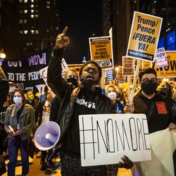 At least 1,000 protesters march through the Loop to demand every vote be counted in the general election, Wednesday night, Nov. 4, 2020.