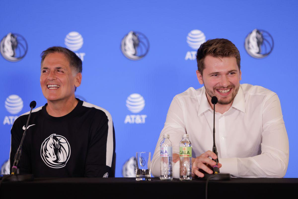 Dallas Mavericks owner Mark Cuban and Luka Doncic speak at a...