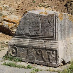 This March 10, 2012 photo shows a fragment of an engraved stone tablet resting in the forum of the ancient Roman city of Sala Colonia outside the Moroccan capital Rabat.
