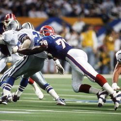 Bruce Smith takes down the ballcarrier in a game against the Dallas Cowboys