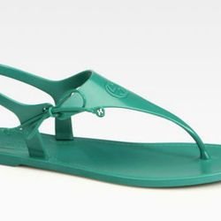 """<b>Gucci</b> Katina Rubber Thong in Jade, <a href=""""http://www.saksfifthavenue.com/main/ProductDetail.jsp?PRODUCT%3C%3Eprd_id=845524446555285"""">$180</a> at Saks Fifth Avenue"""