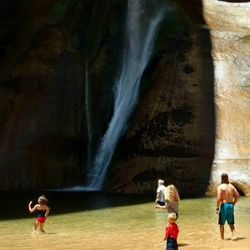 Arianne Brown's family plays in the water at Calf Creek Falls.
