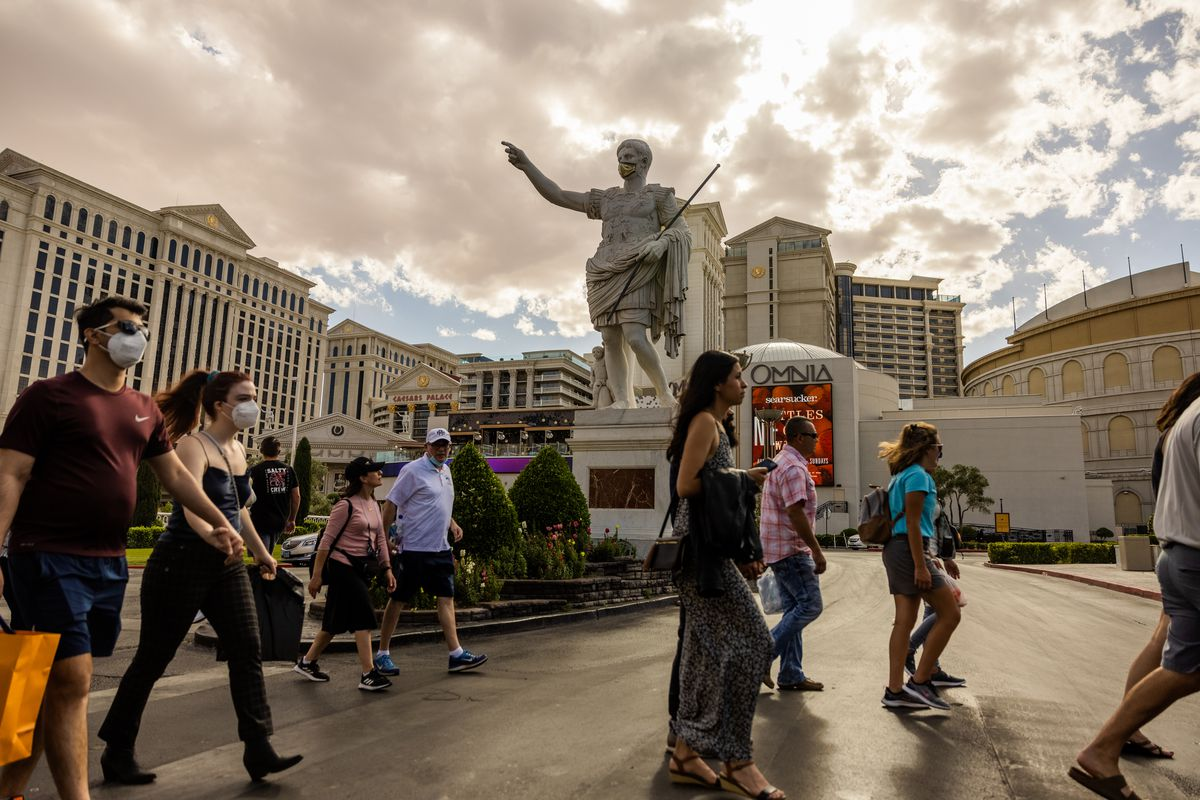 People walking on the street in front of Caesar's Palace casino in Las Vegas, Nevada.