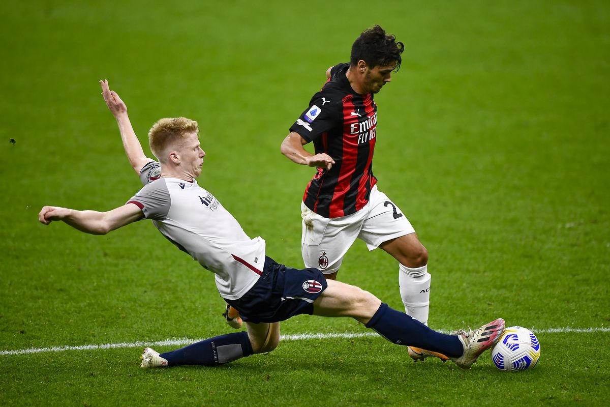 Brahim Diaz (R) of AC Milan is tackled by Jerdy Schouten of...