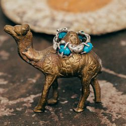 """<a href=""""http://www.rilanyc.com/rings/4-stone-lava-ring"""">Four Stone Lava Ring</a> in sterling silver with turquoise stones, $225"""